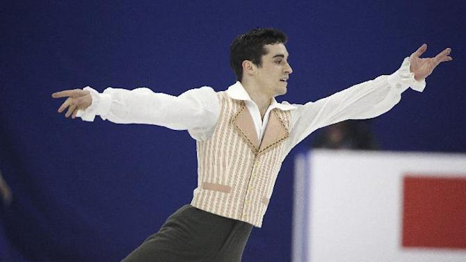 Javier Fernandez of Spain performs during the Men Free Skating event in the ISU World Figure Skating Championship 2015 held at the Oriental Sports Center in Shanghai, China, Saturday, March 28, 2015. Fernandez finished in first place in the event. (AP Photo/Ng Han Guan)