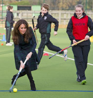 Kate, the Duchess of Cambridge, left, plays hockey during her visit to St. Andrews School, where she attended school from 1986 till 1995, in Pangbourne, England, Friday, Nov. 30, 2012. The Duchess of Cambridge has gone back to school. The royal, formerly known as Kate Middleton, played hockey and revealed her childhood nickname  Squeak  when she returned to her elementary school for a visit Friday. Kate told teachers and students at the private St. Andrew&#39;s School in southern England that her 10 years there were &quot;some of my happiest years.&quot; She said that she enjoyed it so much that she had told her mother she wanted to return as a teacher. (AP Photo/Arthur Edwards, Pool)