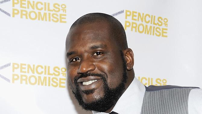 "FILE - This Nov. 17, 2011 file photo shows Shaquille O'Neal at the ""Pencils Of Promise"" inaugural gala in New York. O'Neal is providing a forum for comics for his ""All Star Comedy Jam"" tour.  The twenty-city tour includes urban comics Kevin Hart, Finesse Mitchell, and Gary Owen. The tour ends on New Year's Eve in Atlanta.  (AP Photo/Evan Agostini, file)"