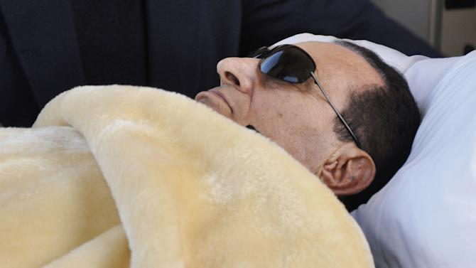 FILE - In this Sunday, Jan. 29, 2012, file photo, former Egyptian President Hosni Mubarak is wheeled into court in Cairo, Egypt. An Egyptian security official said Tuesday, June 5, 2012, that ousted President Hosni Mubarak's health has deteriorated in the three days since a court sentenced him to life imprisonment in connection to the killing of protesters. (AP Photo/Mohammed al-Law, File)