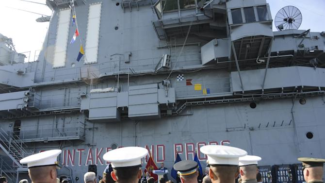 Military service members attend the announcement held aboard the Intrepid Sea, Air & Space Museum of the first-ever Veterans Week NYC scheduled for November 7-14, on Wednesday, Oct. 17, 2012 in New York. (Photo by Charles Sykes/Invision for USO/AP Images)