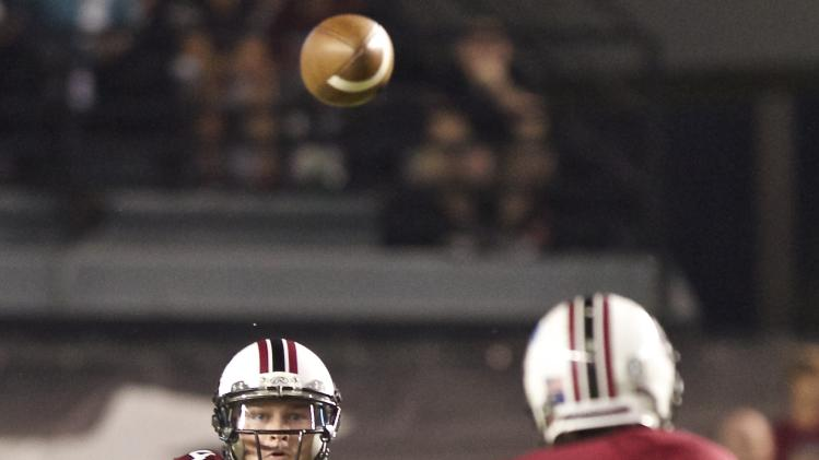 South Carolina quarterback Connor Shaw, left, throws a short pass to running back Marcus Lattimore, right, to pick up a first down, during the first quarter of an NCAA college football game against Georgia in Columbia, S.C., Saturday, Oct. 6, 2012. (AP Photo/Brett Flashnick)