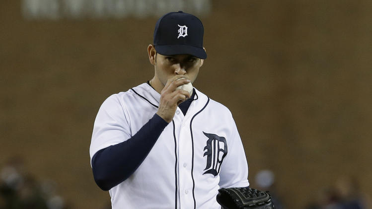 Detroit Tigers pitcher Anibal Sanchez kisses the ball after striking out Atlanta Braves' Reed Johnson in the eighth inning of a baseball game in Detroit, Friday April 26, 2013.  Sanchez struck out 17 in eight innings. (AP Photo/Paul Sancya)