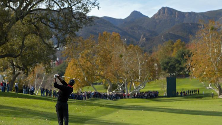 Tiger Woods makes his approach shot on the fourth hole during the final round of the Northwestern Mutual World Challenge golf tournament at Sherwood Country Club, Sunday, Dec. 8, 2013, in Thousand Oaks, Calif. (AP Photo/Mark J. Terrill)