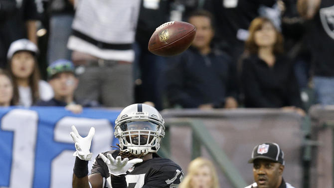 Carr's 3 TDs lead Raiders past Seahawks 41-31