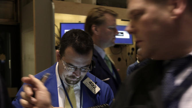"FILE - Trader Richard Scardino, left, works on the floor of the New York Stock Exchange, in this Dec. 14, 2012 file photo taken in in New York. World stock markets faced resistance Thursday Dec. 20, 2012 after talks turned sour among U.S. political leaders trying to reach an agreement over how to avert an economically disastrous ""fiscal cliff"" before the end of the year. A downturn in U.S. housing starts also hurt sentiment.  (AP Photo/Richard Drew, File)"