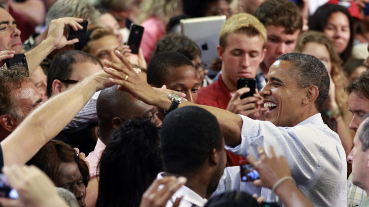 President Barack Obama greets supporters at a campaign event, Sunday, Sept. 9, 2012, in Melbourne, Fla. (AP Photo/John Raoux)