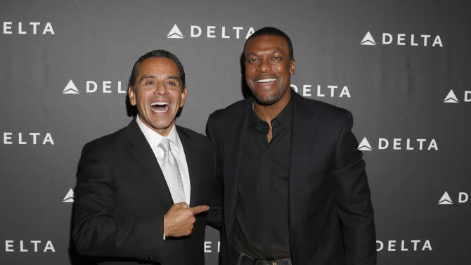 Los Angeles Mayor Antonio Villaraigosa and Chris Tucker arrive at a Celebration of LA's Music Industry at the Getty House on Thursday, Feb. 7, 2013 in Los Angeles. (Photo by Todd Williamson/Invision/AP)