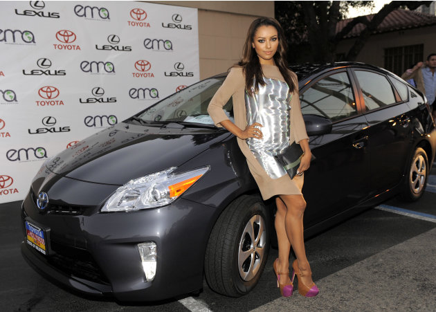 Kat Graham poses with the Toyota Prius at the 22nd Annual Environmental Media Awards on Saturday Sept. 29, 2012, at Warner Bros. Studios in Burbank, Calif. (Photo by Chris Pizzello/Invision for Enviro