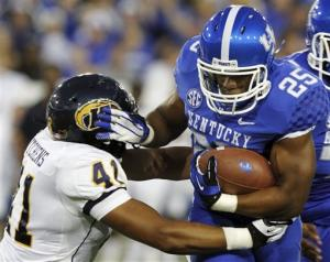 Smith has 4 TDs as Kentucky routs Kent State 47-14
