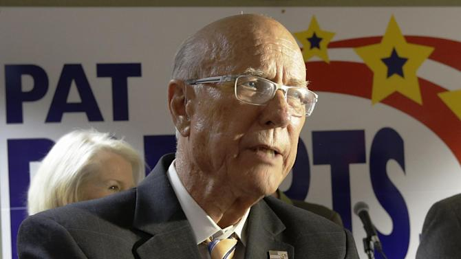 FILE - In this Oct. 23, 2014 file photo, Sen. Pat Roberts, R-Kansas, listens to a supporters question during a campaign stop in Great Bend, Kansas. Few have done more in Congress to affect agricultural policy in the interest of farmers than Kansas Sen. Pat Roberts. But as he scrambles for re-election, the Republican isn't talking much about it. And that worries some supporters in western Kansas, who fear he's not saying enough about the best reason they believe he should be re-elected. (AP Photo/Orlin Wagner, File)