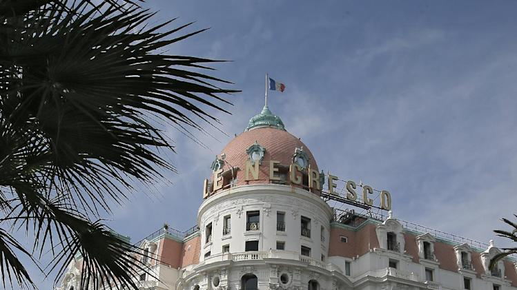 The pack of cyclists ride in front of Negresco hotel in Nice, southeastern France, during the final leg of the Paris-Nice cycling race, Sunday, March 16, 2014. (AP Photo/Lionel Cironneau)