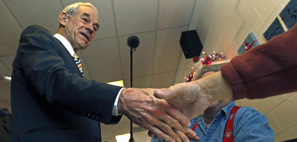 Republican presidential candidate Rep. Ron Paul, R-Texas, shakes hands while campaigning at the Early Bird Cafe in Plaistow, N.H., Tuesday Dec. 20, 2011. (AP Photo/Charles Krupa)