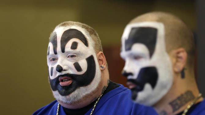 FILE --In this Jan. 8, 2014 file photo, Joseph Bruce, aka Violent J, left, and Joseph Utsler, aka Shaggy 2 Dope, members of the Insane Clown Posse, address the media in Detroit. The U.S. Justice Department is asking a judge to dismiss a lawsuit by Insane Clown Posse, which objects to a report that describes its fans as a dangerous gang. A Detroit federal judge holds a hearing Monday, June 23, 2014. The government says the rap-metal duo from the Detroit area and its fans have no standing to sue. (AP Photo/Carlos Osorio)