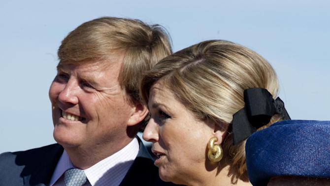 FILE - In this April 30, 2012 file photo, Crown Prince Willem Alexander, his wife Princess Maxima, and Dutch Queen Beatrix, right, listen to singing children during festivities marking Queen's Day in Rhenen, central Netherlands. Queen Beatrix announced she is to abdicate in favor of Crown Prince Willem Alexander during a nationally televised speech Monday, Jan. 28, 2013. Beatrix, who turns 75 on Thursday, has ruled the nation of 16 million for more than 32 years and would be succeeded by her eldest son, Crown Prince Willem-Alexander. (AP Photo/Peter Dejong, File)