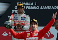 (From left) McLaren Mercedes&#39; British driver Lewis Hamilton and Ferrari&#39;s Spanish driver Fernando Alonso celebrate on the podium at the Autodromo Nazionale circuit in Monza after the Italian Formula One Grand Prix. Ferrari team chief Stefano Domenicali believes Hamilton and Kimi Raikkonen are now a major threat to Alonso&#39;s hopes of winning a third world championship