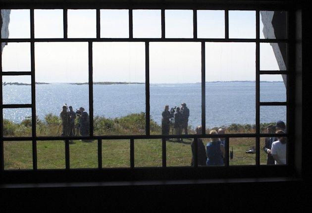 A back window in painter Winslow Homer's studio gives a view of the ocean that he depicted in his best-known paintings, Monday, Sept. 17, 2012, in Scarborough, Maine. The home where Homer lived and worked from 1883 until his death in 1910 is opening to the public following a multiyear, multimillion-dollar renovation by the Portland Museum of Art. Workers restored the exterior to its original colors, replaced the second-floor balcony, stabilized the foundation and replaced windows. The home will be open for public tours on Sept. 25. (AP Photo/Clarke Canfield)