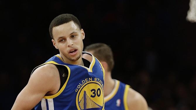 Golden State Warriors' Stephen Curry reacts after scoring during the first half of an NBA basketball game against the New York Knicks, Wednesday, Feb. 27, 2013, in New York. (AP Photo/Frank Franklin II)