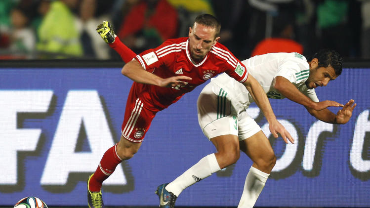 Zakaria El Hachimi of Morocco's Raja Casablanca fights for the ball with Franck Ribery of Germany's Bayern Munich during their 2013 FIFA Club World Cup final soccer match at Marrakech stadium