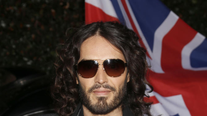 Russell Brand attends the Topshop Topman LA Opening Party At Cecconi's in Los Angeles, on Wednesday, Feb. 13, 2013 in Los Angeles. (Photo by Todd Williamson/Invision for/AP)