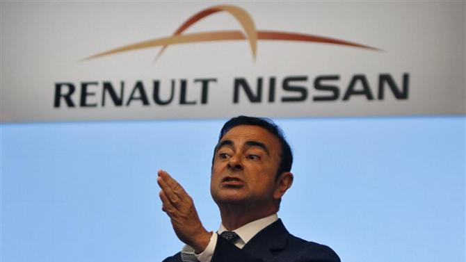 Carlos Ghosn, chairman and CEO of the Renault-Nissan Alliance, gestures as he speaks at a news conference in Chennai