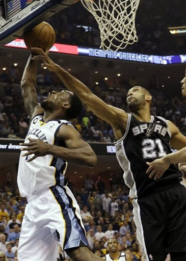 Memphis Grizzlies guard Tony Allen (9) drives to the basket as San Antonio Spurs forward Tim Duncan (21) reaches for the ball during the first half of Game 3 in their NBA basketball Western Conference