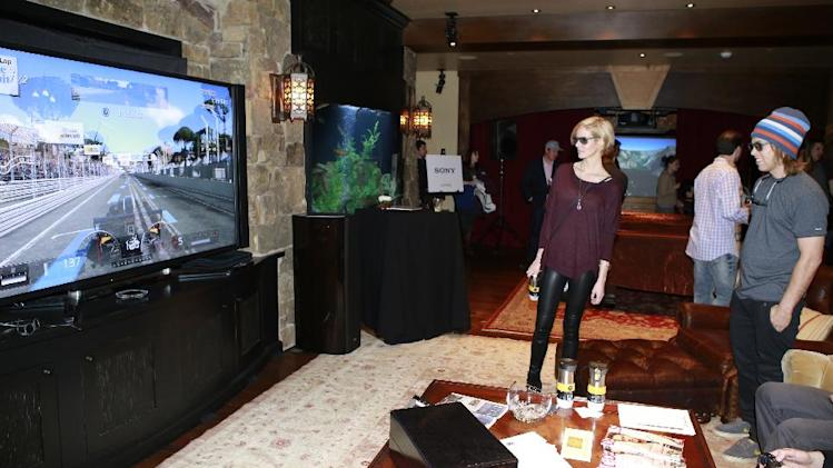"IMAGE DISTRIBUTED FOR RAND LUXURY - Whitney Pratt, left, and Kevin Pearce from the film ""The Crash Reel"" watch a game on a Sony 84-inch 4k Television at Resorts West House of Luxury, on Monday, Jan. 21, 2013 in Deer Valley, Utah. (Photo by Benjamin Cohen/Invision for Rand Luxury/AP Images)"