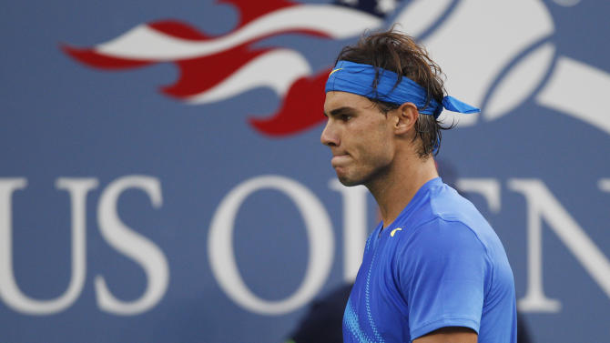 FILE - This Sept. 12, 2011 file photo shows Rafael Nadal of Spain reacting during the championship match against Novak Djokovic of Serbia at the U.S. Open tennis tournament in New York. Nadal has withdrawn from the 2012 U.S. Open tournament. (AP Photo/Charles Krupa)