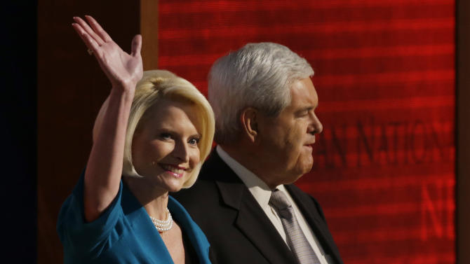 Former House Speaker Newt Gingrich and his wife Callista walk onto the stage to speak to delegates during the Republican National Convention in Tampa, Fla., on Thursday, Aug. 30, 2012. (AP Photo/Charlie Neibergall)