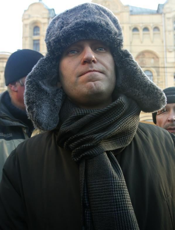 Russian opposition leader Alexei Navalny arrives at an unauthorized rally in Lubyanka Square in Moscow, Russia, Saturday, Dec. 15, 2012. Thousands of opposition supporters gathered Saturday in central Moscow for an unauthorized rally to mark a year of a wave of massive protests against Vladimir Putin and the government. Several prominent opposition figures were detained in the course of the gathering, which was not sanctioned by authorities. (AP Photo/Misha Japaridze)
