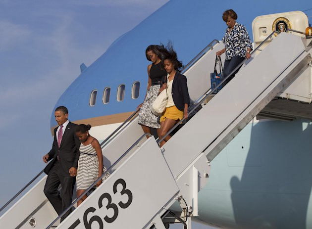 From left, President Barack Obama, Sasha Obama, first lady Michelle Obama,  Malia Obama and Michelle's mother Marian Robinson arrive at Chicago O'Hare International Airport on Air Force One, Friday, J