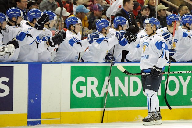 Mikael Granlund #20 of Team Finland celebrates his third period goal with team mates during the 2012 World Junior Hockey Championship game against Team USA at Rexall Place on December 28, 2011 in Edmonton, Alberta, Canada. Team Finland defeated Team USA 4-1. (Photo by Richard Wolowicz/Getty Images)