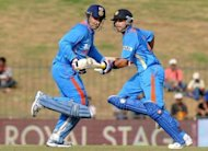 Indian cricketers Virat Kohli (right) and Virender Sehwag (left) run between wickets during the opening one-day international match against Sri Lanka in Hambantota. India defeated Sri Lanka by 21 runs in the opening one-day international in Hambantota to gain a 1-0 lead in the five-match series
