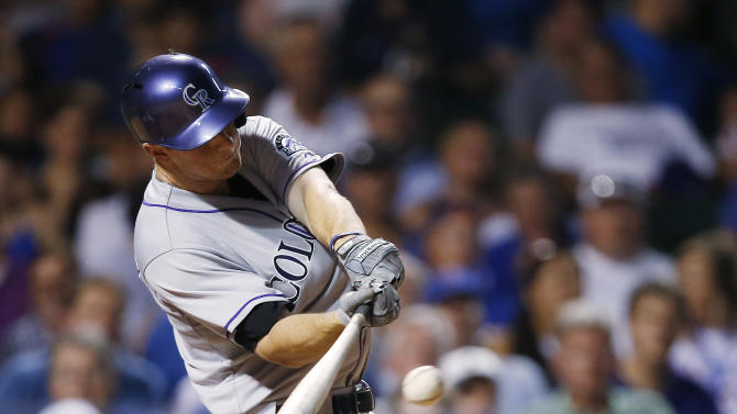 Colorado Rockies' DJ LeMahieu connects for a triple against the Chicago Cubs during the fifth inning of a baseball game in Chicago, Tuesday, July 28, 2015. (AP Photo/Andrew A. Nelles)