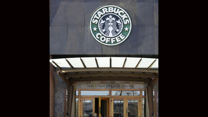 FILE - Starbucks' corporate headquarters is seen in this Monday, Jan. 26, 2009 file photo taken, in Seattle. Starbucks says guns are no longer welcome in its cafes, though it is stopping short of an outright ban on firearms. The Seattle-based company plans to buy ad space in major national newspapers including The New York Times, Wall Street Journal, Washington Post and USA Today on Thursday Sept. 19, 2013 to run an open letter from CEO Howard Schultz explaining the decision. (AP Photo/Elaine Thompson, File)