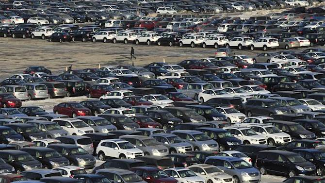 General Motors' new Chinese-made cars are seen at a parking lot in Shenyang