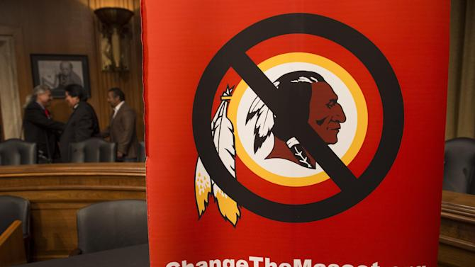 """A poster for the """"Change the Mascot"""" campaign is seen prior to a press conference by the Oneida Indian Nation leaders on Capitol Hill in Washington, DC, September 16, 2014"""
