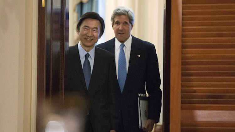 U.S. Secretary of State John Kerry, right, enters a news conference with South Korean Foreign Minister Yun Byung-Se, at the State Department in Washington, on Tuesday, April 2, 2013. (AP Photo/Jacquelyn Martin)