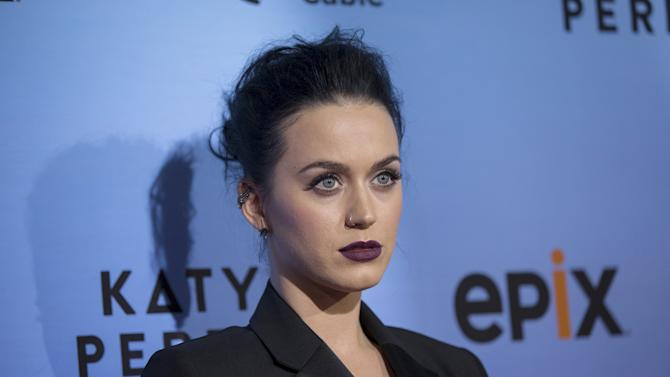 "Singer Perry poses at the premiere screening of ""Katy Perry: The Prismatic World Tour"" in Los Angeles"