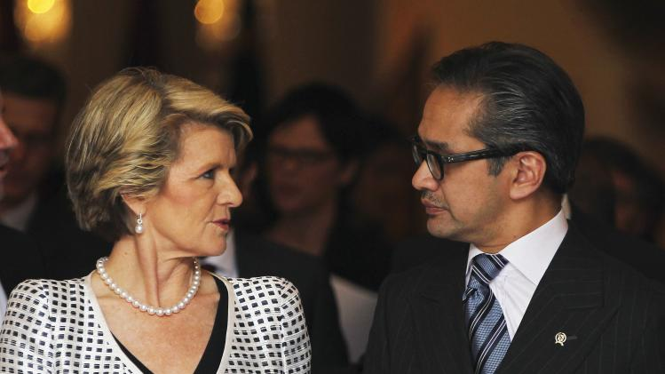 Australia's Foreign Minister Bishop talks to her Indonesian counterpart Natalegawa after their meeting in Jakarta