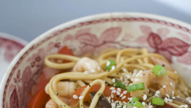 In this image taken on January 14, 2013, shrimp and shitake noodle stir-fry is shown served in a bowl in Concord, N.H. (AP Photo/Matthew Mead)