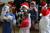 Syrian children take part in a Christmas pageant at a kindergarten in the Syrian capital Damascus, on December 19, 2013
