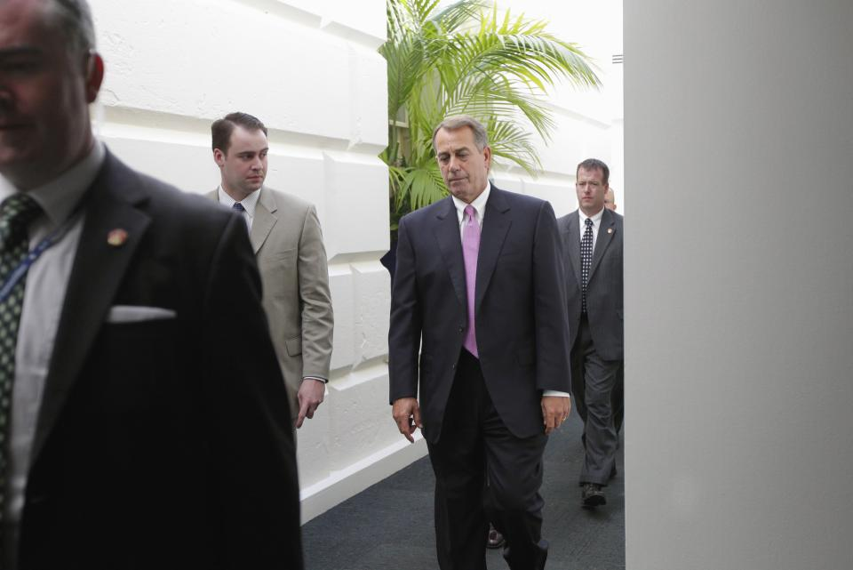 House Speaker John Boehner of Ohio walks through a basement corridor in the Capitol in Washington, Wednesday, July 27, 2011, after an afternoon caucus with House Republicans seeking an agreement on legislation to raise the nation's debt limit. (AP Photo/J. Scott Applewhite)
