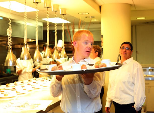 A waiter serves desserts at the McDonald's Unwrapped culinary event for charity. The event was held at the California Culinary Academy on Thursday, Oct. 4, 2012, in San Francisco. The three well-known