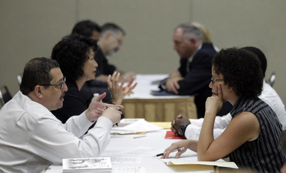 A job seeker, at right, has her resume critiqued during a job fair sponsored by the California Job Journal Tuesday, Sept. 20, 2011 in South San Francisco, Calif. (AP Photo/Marcio Jose Sanchez)