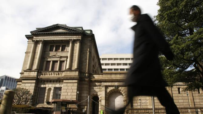 A man walks past in front of the Bank of Japan in Tokyo