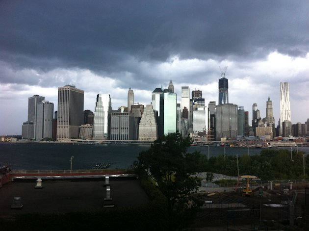 In this photo provided by Gothamist, dark clouds loom over the skyline, Saturday, Sept. 8, 2012, in New York. Two tornadoes struck New York City on Saturday, one swept out of the sea and hit a beachfr