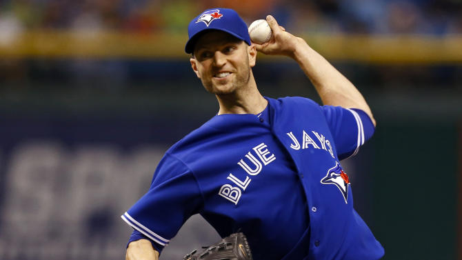 Toronto Blue Jays starting pitcher J.A. Happ throws during the first inning of a baseball game against the Tampa Bay Rays Tuesday, May 7, 2013, in St. Petersburg, Fla. (AP Photo/Mike Carlson)