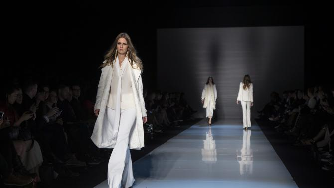 A model shows a creation from Pink Tartan while walking the runway during Toronto Fashion Week in Toronto on Monday, October 20, 2014.  (AP Photo/The Canadian Press, Chris Young)