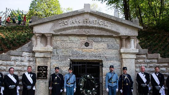 Pallbearers and members of the Veterans Reserve Corps stand at attention in front of the original receiving vault during Abraham Lincoln's 150th anniversary funeral procession Sunday, May 3, 2015, in Springfield, Ill. Thousands of people, including many in period costume, gathered at the Old State Capitol, where the 16th president lay in state, to pay tribute to the simple, country lawyer who saved the Union and thrust the nation toward abolishing slavery. (Justin L. Fowler/The State Journal-Register via AP)